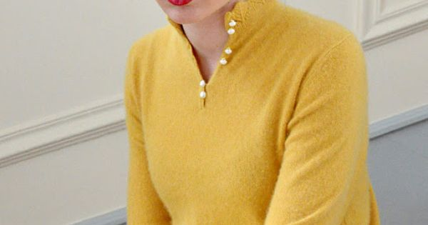 mustard sweater, black frames, red lips