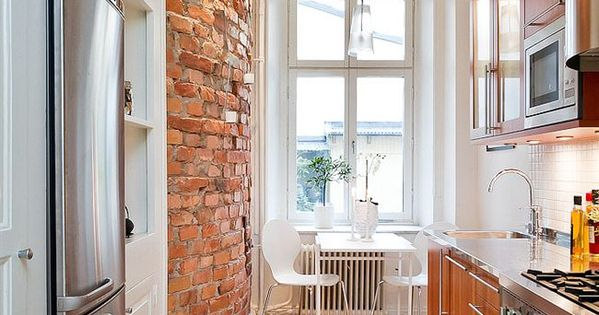 Galley kitchen with brick accent wall