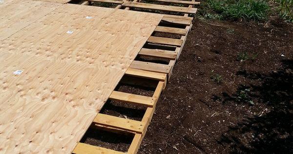 DIY deck. Pallets, wood, and a good nail gun.