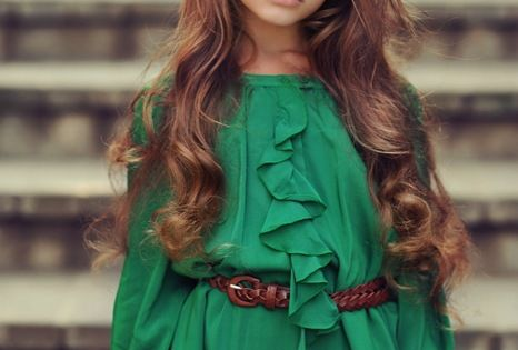 beautiful little girl. Pretty hair and pretty green dress