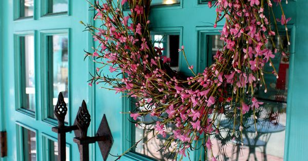 Turquoise doors with pink blossome wreath from House of Turquoise the doors