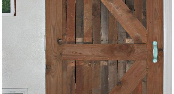 Diy interior sliding barn door on the cheap to separate for Cheap sliding barn doors