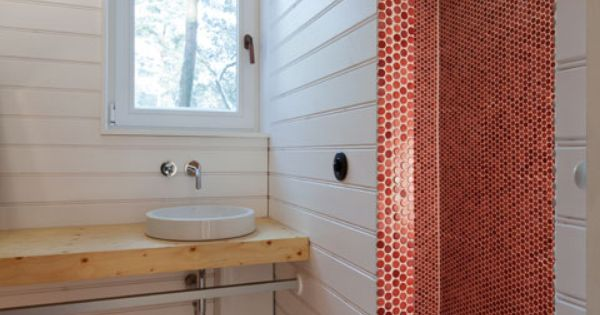 bath in the Wooden cabin by Atelier St; wood slab counter; red