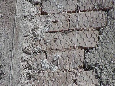 Galvanized Light Hexagonal Wire Mesh Is Fixed On Wall By
