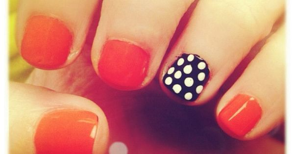 black + white polka dots nails.