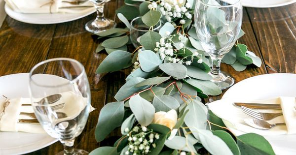 Long Feasting Table With Garland Greenery Centerpieces And