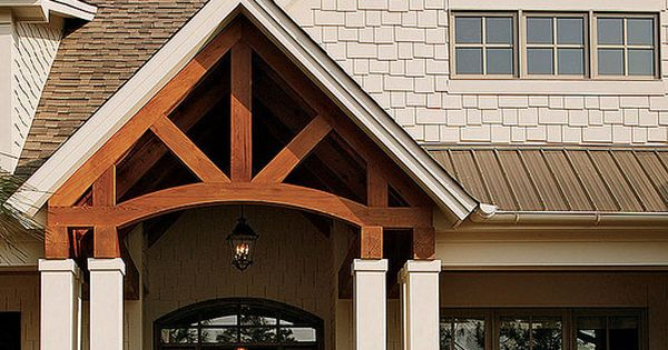 This rustic home has tons of curb appeal with gable for Craftsman gable brackets