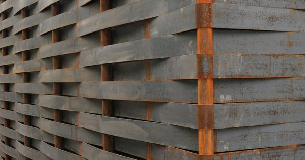 steel weaving wall facade - could work with wood strips as a