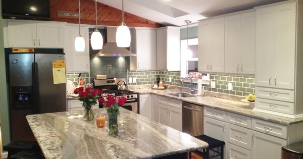 Modern Kitchen Update Featuring Dayton Painted White Mission Kitchen Cabinets Surrounding The