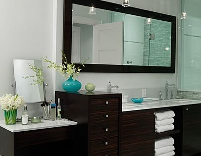 Master bathroom. Designed by Sarah Richardson. Dark wood cabinets, glass shower, framed