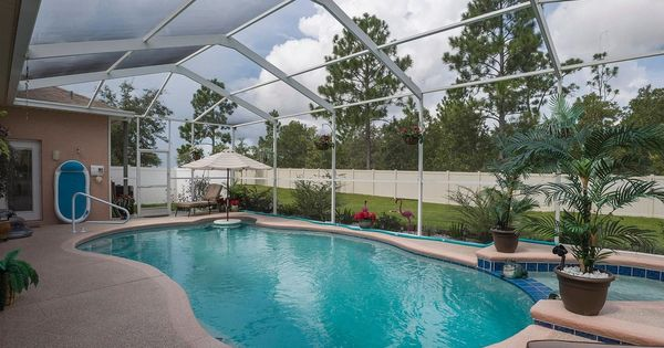 Tropical swimming pool with round polyresin mesa planter for Indoor swimming pools in mesa az