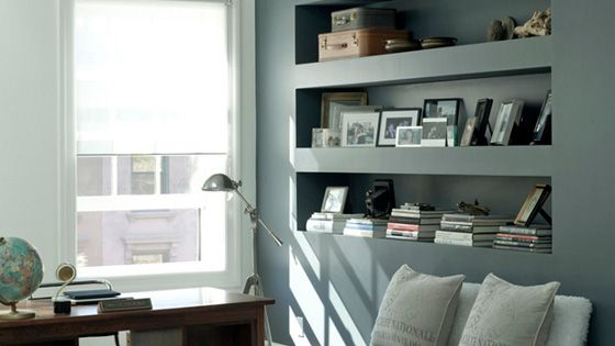Gorgeous wall color. Love these built in shelves.