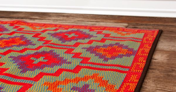 Indoor/outdoor rug woven from recycled plastic straws