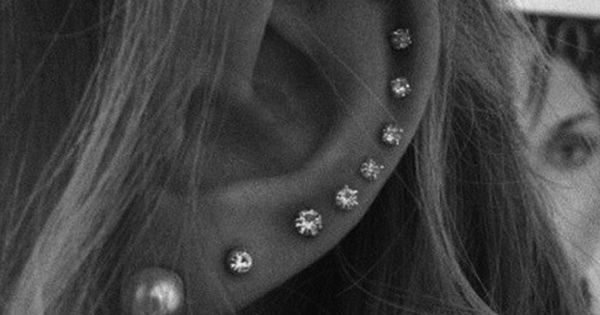 i don't know if i like the whole ear part, but i definitely love the look of multiple piercings all in a row.