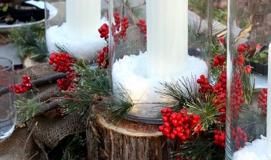 Easy Christmas centerpiece with epsom salt, candles, and holly around the bottom