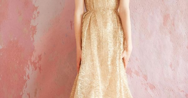 I love this SarahSeven gold wedding dress. This sequin and glitter gown
