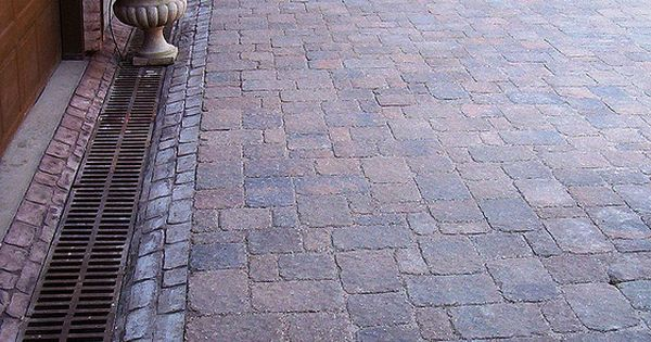 Paver Driveway With Drainage Channel Outdoors