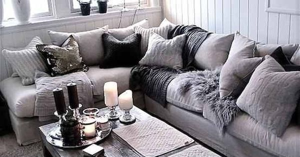cozy living room - wooden coffee table, big comfy couch and fluffy