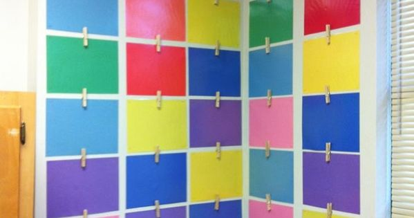 CLASSROOM ART DISPLAY laminated pieces of paper with pegs hot glue gunned