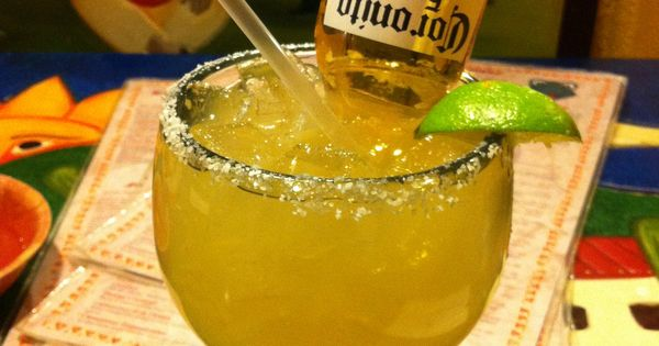 """Margarita bomb - a regular margarita with a Coronita suspended in it."
