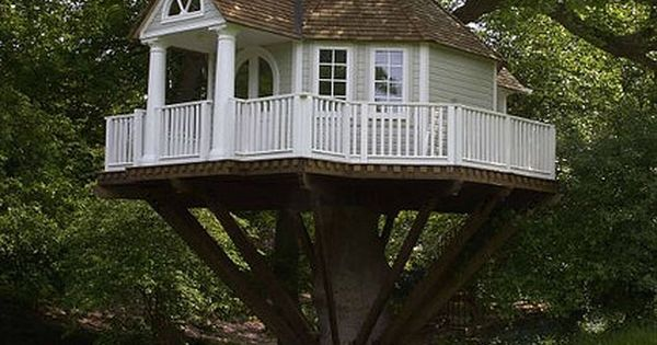 Tree house with white picket fence