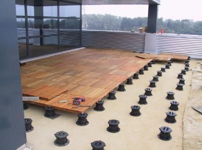 Structural Deck Tiles For Uneven Surfaces Maybe Would Be An Option For The Uneven Grass In The Backyard Pin Outdoor Wood Decking Outdoor Deck Tiles Deck Tiles