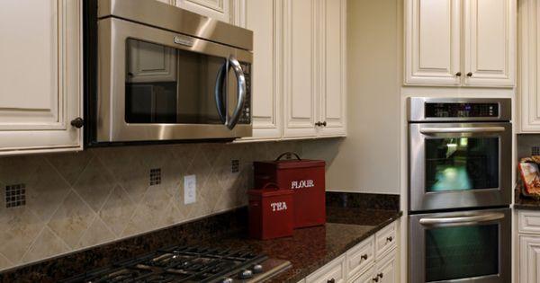 Biscotti With Cocoa Glaze Cabinets And Dark Brown Granite