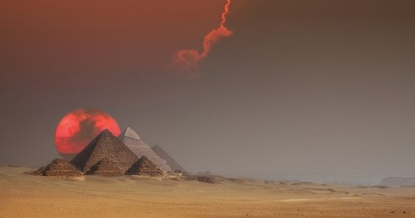 Spectacular photo of Sunset Behind the Pyramids of Giza, Egypt