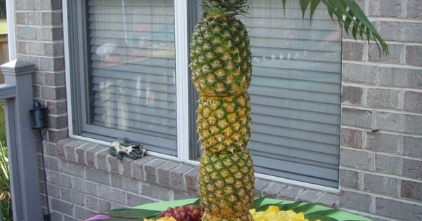 Sooo cute for a summer party idea!! Pineapple Palm Tree Fruit Display!!