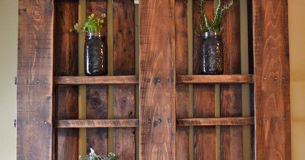 Stained wood pallet wall shelves. Nice rustic look.