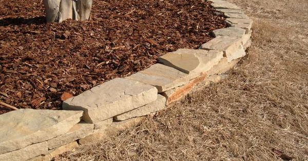 flagstone stack gives your yard definition and keeps your mulch in