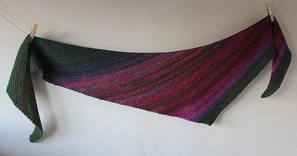 Boom! is a very simple asymmetric boomerang shawl, knit in garter stitch with...