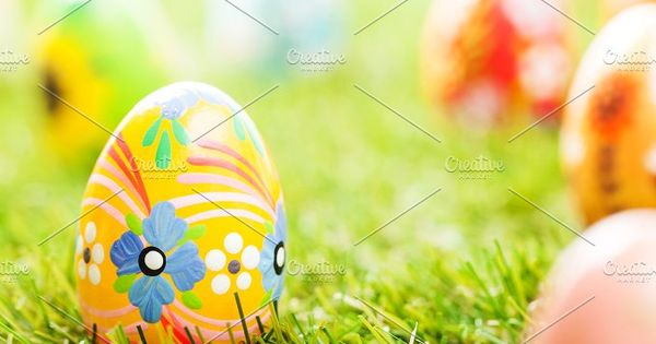 Unique Easter eggs on the grass – Colorful hand painted Easter eggs in grass. Spring theme.