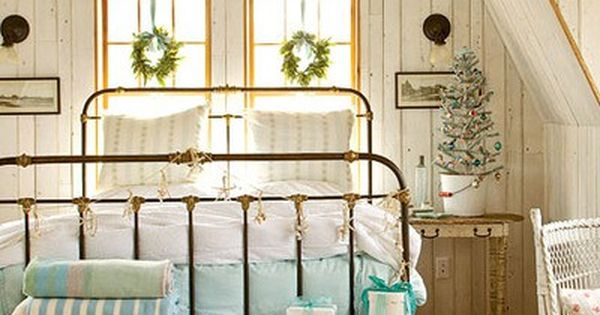 white barnwood walls, iron bed frame, window frames