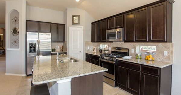 Backsplash In This Kitchen From Lennar San Antonio Dark Wood Cabinets