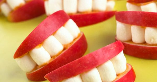 Fun for kids Halloween party! apple slices, peanut butter and marshmallows for