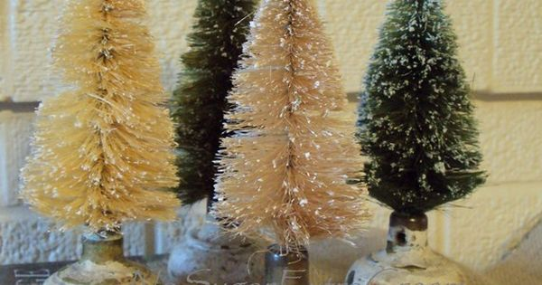great idea - old door knobs as bottle brush tree stands I