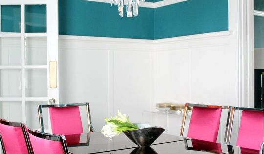 White molding and a bold wall color, crystal chandelier and a metal