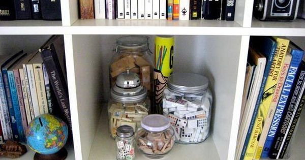 Store puzzles, dominos and game pieces in decorative glass jars instead of
