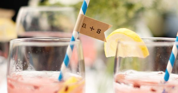 Coral Signature drink and paper straw with pennant