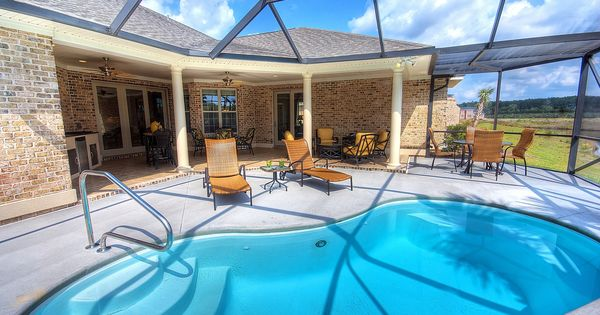 This swimming pool is perfect with the screened lanai for Lanai structure