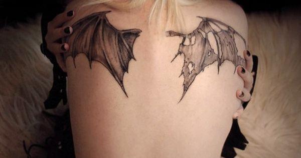 Bat wings back tattoo