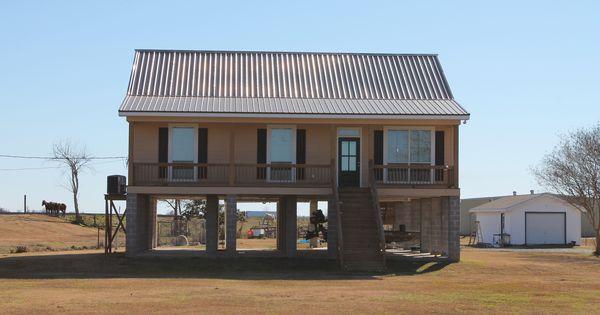 Raised Vermillion House On Stilts The