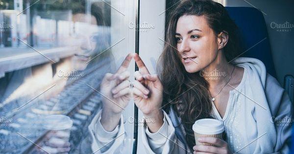 Young beautiful woman looking through the train window