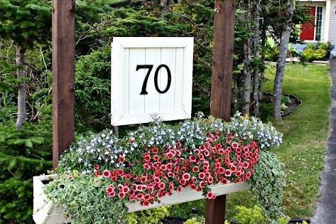 A DIY house number sign including a flower box