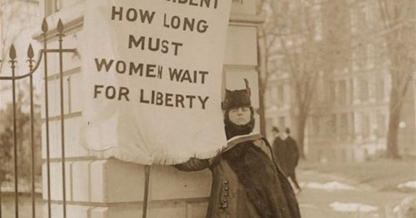 "Photograph of Alison Turnbull Hopkins with banner, ""Mr. President How long must"