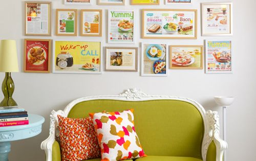 Love the colors and display of magazines! green sofa couch frames magazines