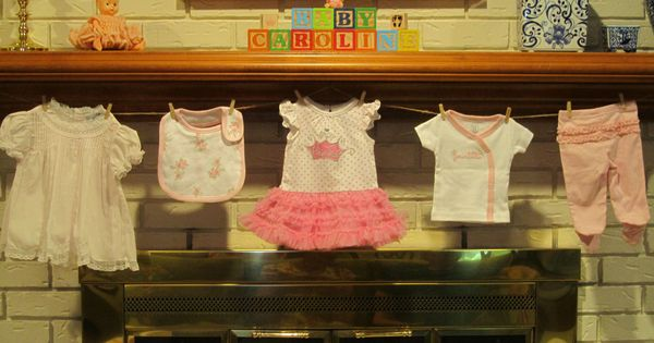 Baby shower clothesline mantle decor she 39 s crafty for Baby clothesline decoration