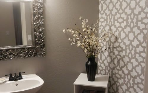 Pretty stenciled wall in powder room. Before and after DIY projects that