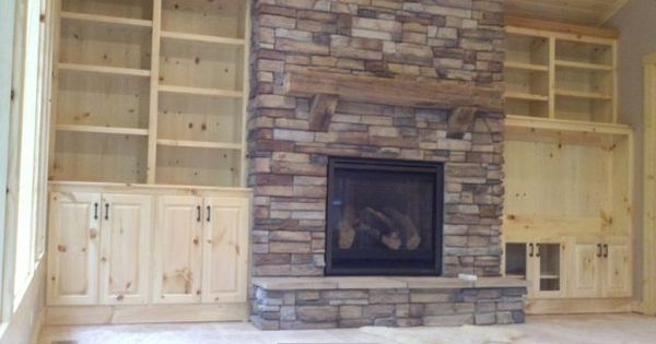 Stacked Stone Fireplace With Built In Shelves